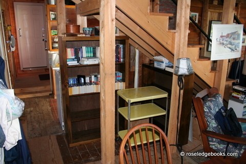 "Fig. #74.  Think browsing shelves as you look through the Roseledge Books' List, even if you have to twist awkwardly to see the ""extras"" shelved beneath the stairs of Roseledge."